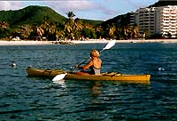 [IMG: Sea-kayaking with the Atrium on the right] (c) 1997 GoBeach Vacations