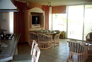 [IMG: Living area one/two bedroom suite] (c) 1997 GoBeach Vacations